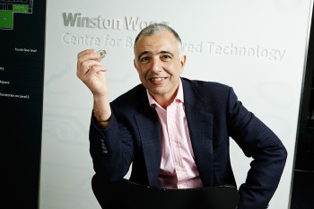 Imperial College London Professor Christofer Toumazou with his Genealysis chip, which can analyze DNA within 30 minutes and without a laboratory. The chip is powered by a mechanism that uses biology input from DNA to run analysis. The patented mechanism is now nominated for a 2014 European Patent Office Inventor Award.