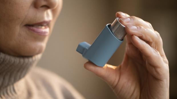senior-woman-holding-asthma-inhaler